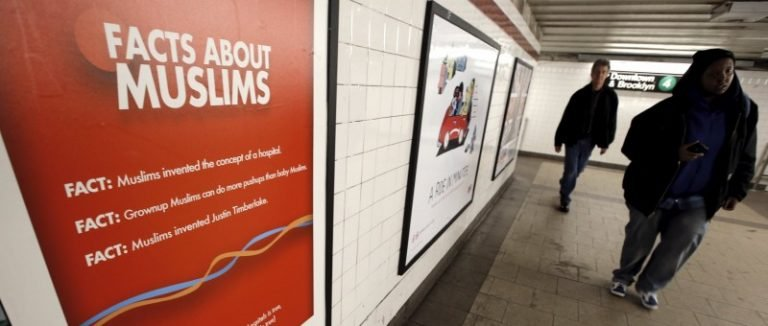 """A poster promoting the new documentary film """"The Muslims Are Coming is seen inside the City Hall subway station in the Manhattan borough of New York City"""