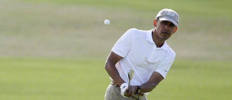 U.S. President Barack Obama plays a shot to the 18th green as he finishes a round of golf with friends at the Mid-Pacific Country Club in Kailua, Hawaii in this December 28, 2015 file photo. REUTERS/Jonathan Ernst/Files