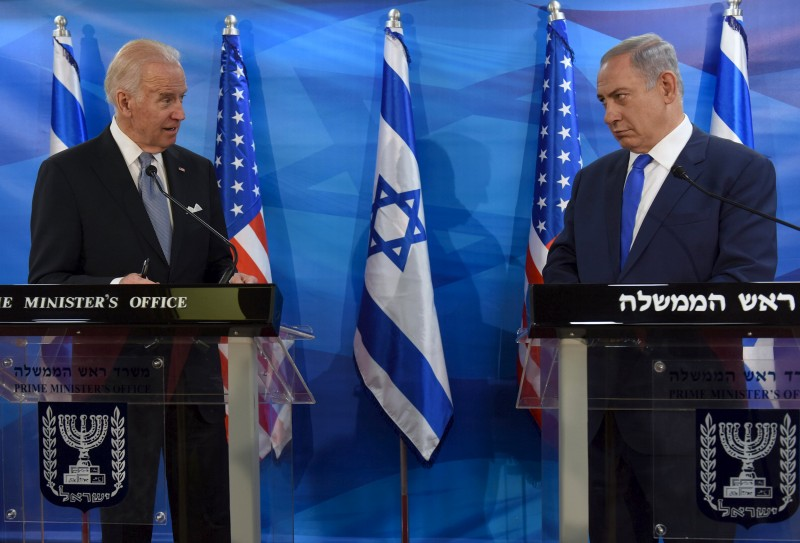 U.S. Vice President Joe Biden (L) and Israeli Prime Minister Benjamin Netanyahu look at each other as they deliver joint statements during their meeting in Jerusalem March 9, 2016. REUTERS/Debbie Hill/Pool