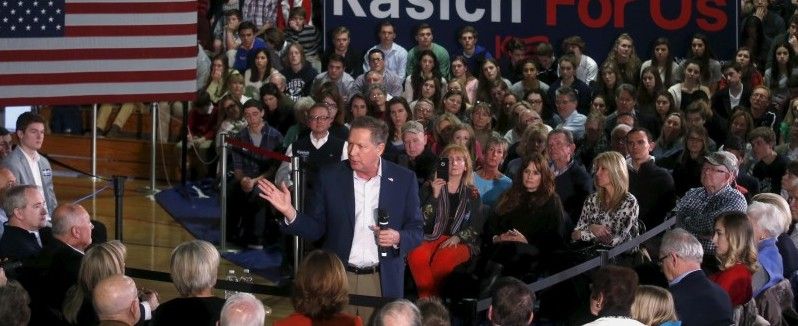 John Kasich addresses supporters during a campaign stop in the gymnasium of University Liggett School in Grosse Pointe Woods, Michigan, March 7, 2016. REUTERS/Rebecca Cook