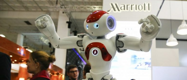A Zora Bots humanoid robot called 'Mario', which is used in the workflow of the Ghent Marriott Hotel in Belgium, dances at the Marriott exhibition stand on the International Tourism Trade Fair (ITB) in Berlin, Germany, March 9, 2016. REUTERS/Fabrizio Bensch