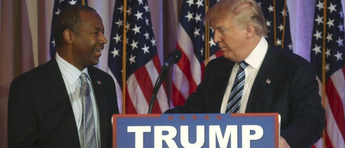 Republican U.S. presidential candidate Trump greets former Republican presidential candidate Carson after receiving endorsement in Palm Beach, Florida