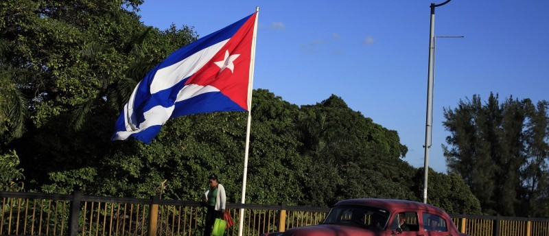 A Cuban flag flies over 'Almendares' bridge in Havana