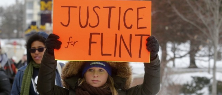 Demonstrators protest over the Flint, Michigan contaminated water crisis outside of the venue where the Democratic U.S. presidential candidates' debate was being held in Flint, Michigan in this March 6, 2016 file photo. REUTERS/Rebecca Cook Files