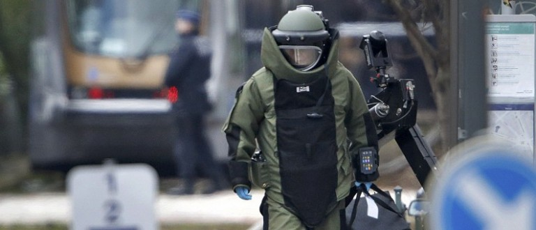 A bomb disposal expert takes part in a search in the Brussels borough of Schaerbeek following Tuesday's bombings in Brussels.