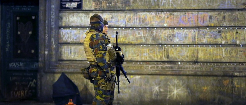 Belgian soldiers patrol at the Place de la Bourse in Brussels