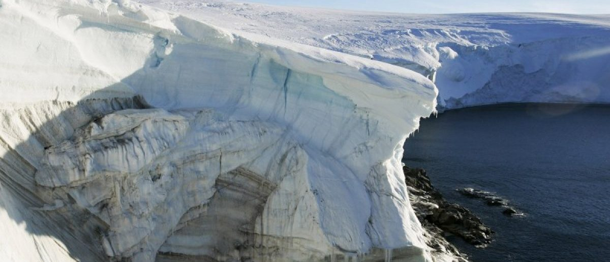 File photo shows melting ice through at a cliff face at Landsend, on the coast of Cape Denison in Antarctica