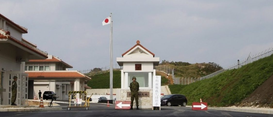 A Japan's Self Defence Force soldier keeps watch at the entrance of the newly opened military base on the island of Yonaguni in the Okinawa prefecture, March 28, 2016. REUTERS/Nobuhiro Kubo