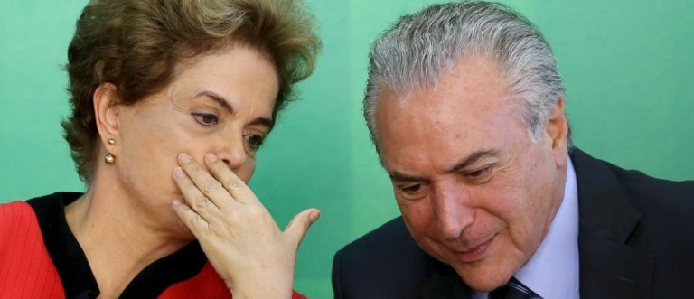 File photo of Brazil's President Dilma Rousseff talking to Vice President Michel Temer at the Planalto Palace in Brasilia
