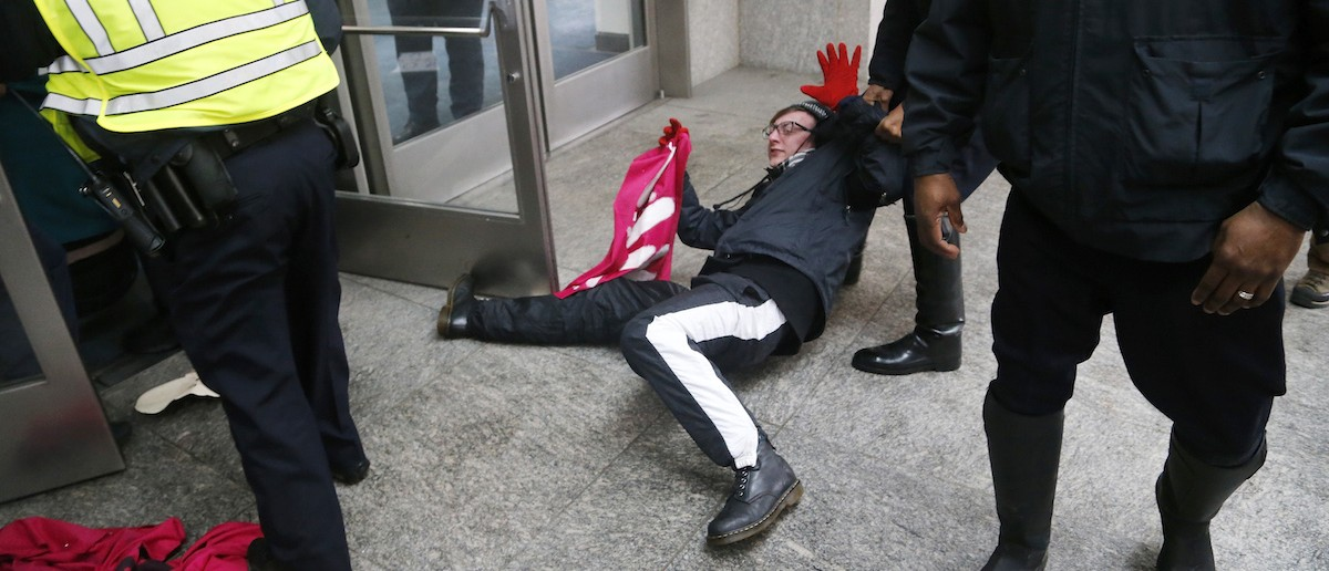 Police forcibly remove anti-Israel demonstrators led by the protest group Code Pink from the entrance to the American Israel Public Affairs Committee (AIPAC) policy conference at the Washington Convention Center in Washington