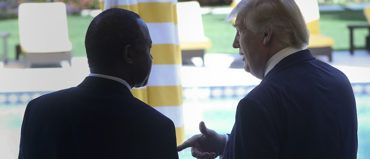 Republican presidential candidate Donald Trump speaks with Ben Carson after receiving Carson's endorsement at a campaign event in Palm Beach, Fla., March 11, 2016. (REUTERS/Carlo Allegri)
