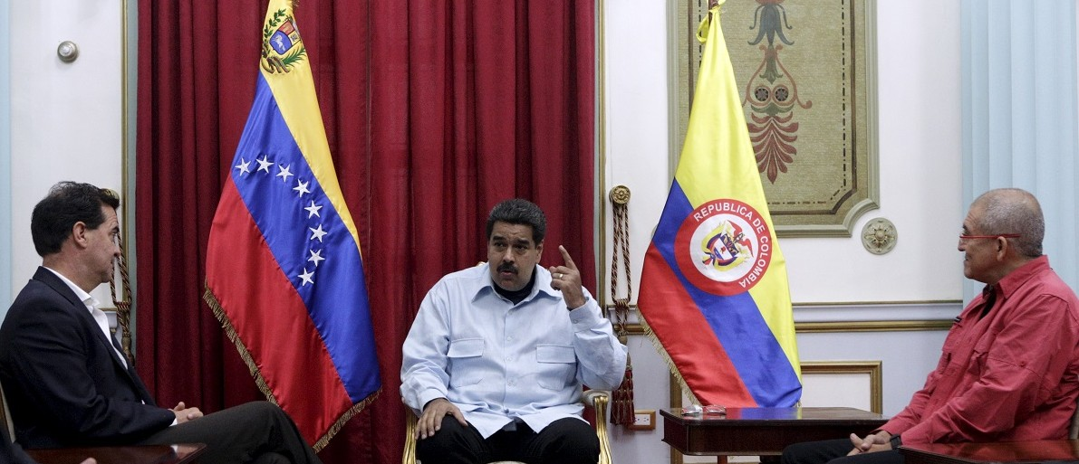 Venezuela's President Maduro speaks during a meeting with Frank Pearl, representative of Colombian government and Antonio Garcia, of National Liberation Army (ELN), in Caracas