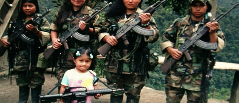 FARC rebels pose with an unidentified girl holding a weapon in southern Colombia