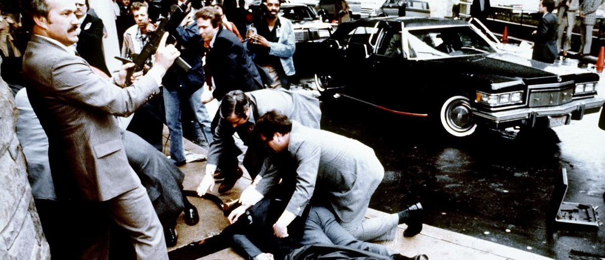 Police and Secret Service reacting during the assassination attempt on Ronald Reagan (Mike Evens/AFP/Getty Images)