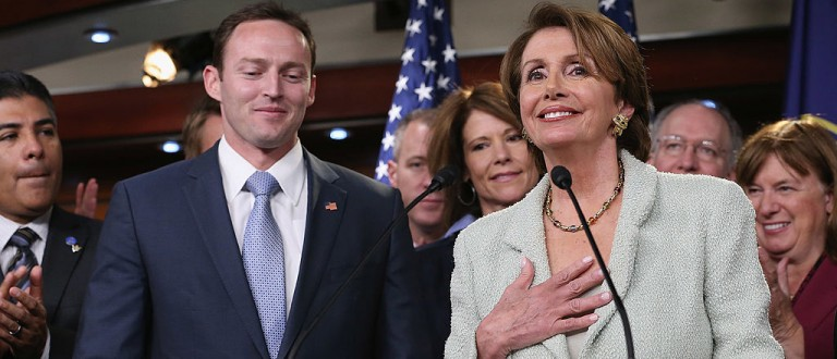 """WASHINGTON, DC - NOVEMBER 13:  House Minority Leader Nancy Pelosi (D-CA) (R) holds a news conference to introduce 37 of the newly-elected House Democratic Members, including Patrick Murphy (D-FL) (2nd L) at the U.S. Capitol November 13, 2012 in Washington, DC. Pelosi called the conference to """"highlight the size and historic diversity of the incoming House Democratic freshmen class.""""  (Photo by Chip Somodevilla/Getty Images)"""