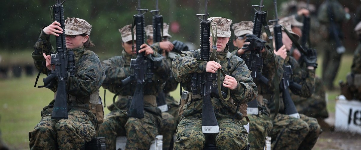 Female Marine recruits prepare to fire on the rifle range during boot camp February 25, 2013 at MCRD Parris Island, South Carolina. All female enlisted Marines and male Marines who were living east of the Mississippi River when they were recruited attend boot camp at Parris Island. About six percent of enlisted Marines are female. Scott Olson/Getty Images.