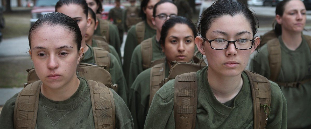 Female Marine recruits stand in formation during boot camp February 25, 2013 at MCRD Parris Island, South Carolina. All female enlisted Marines and male Marines who were living east of the Mississippi River when they were recruited attend boot camp at Parris Island. About six percent of enlisted Marines are female.  Scott Olson/Getty Images.
