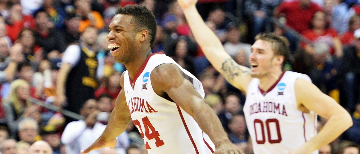 COLUMBUS, OH - MARCH 22: Buddy Hield #24 and Ryan Spangler #00 of the Oklahoma Sooners celebrate their 72 to 66 win over the Dayton Flyers during the third round of the 2015 NCAA Men's Basketball Tournament at Nationwide Arena on March 22, 2015 in Columbus, Ohio. (Photo by Jamie Sabau/Getty Images)