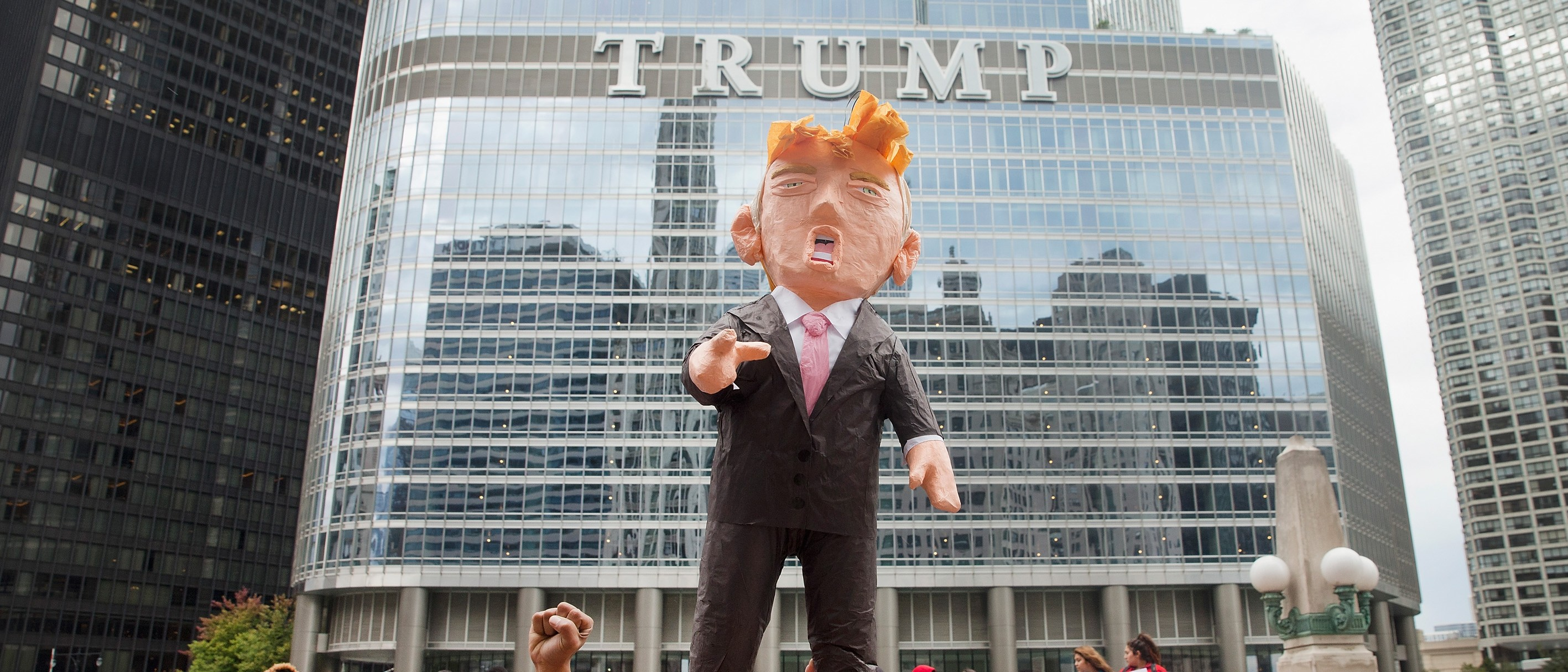 CHICAGO, IL - OCTOBER 12: Demonstrators hold up a piñata of Republican Presidential candidate Donald Trump during a protest outside Trump Tower on October 12, 2015 in Chicago, Illinois. About 250 demonstrators marched through downtown before holding a rally calling for immigration reform and fair wages in front of Trump Tower. Trump has been an outspoken proponent of a plan to deport undocumented immigrants. (Photo by Scott Olson/Getty Images)