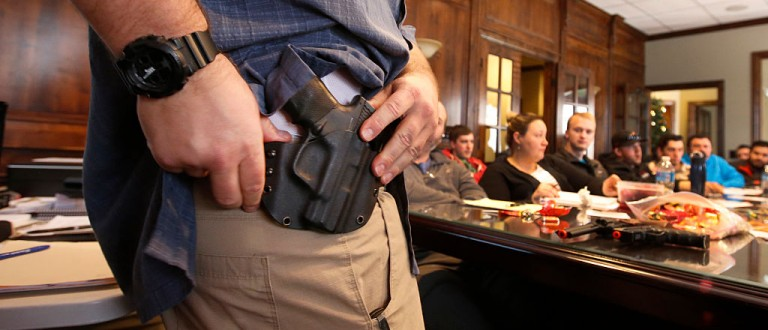 Damon Thueson shows a holster at a gun concealed carry permit class put on by 'USA Firearms Training' on Dec. 19, 2015 in Provo, Utah