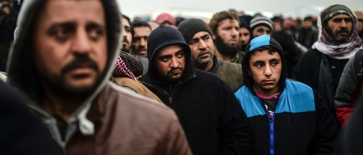 Refugees wait for tents as Syrians fleeing the northern embattled city of Aleppo wait on February 6, 2016 in Bab al-Salama, near the city of Azaz, northern Syria, near the Turkish border crossing. (Photo: BULENT KILIC/AFP/Getty Images)