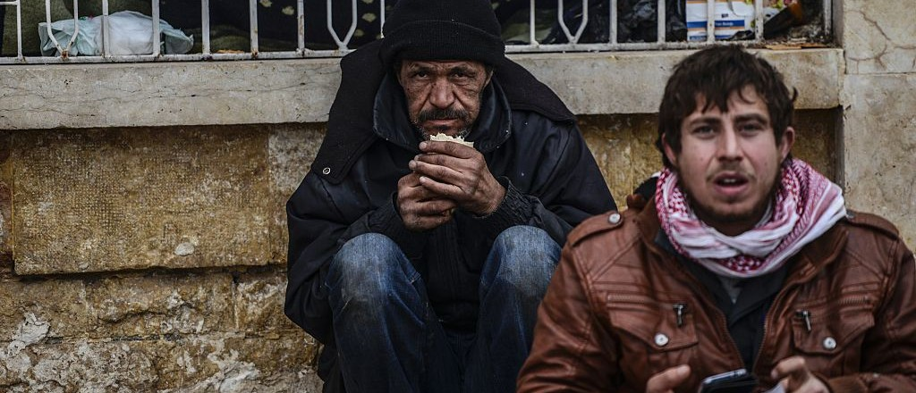 Thousands of Syrians were braving cold and rain at the Turkish border Saturday after fleeing a Russian-backed regime offensive on Aleppo that threatens a fresh humanitarian disaster in the country's second city. Around 40,000 civilians have fled their homes over the regime offensive, according to the Syrian Observatory for Human Rights monitor. / AFP / BULENT KILIC        (Photo credit should read BULENT KILIC/AFP/Getty Images)