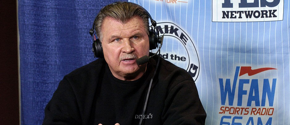 NFL Pro Football Hal of Famer Mike Ditka talks to the WFAN radio at the Jacksonville Convention Center on Feb. 2, 2005. (Photo by Al Messerschmidt/Getty Images)