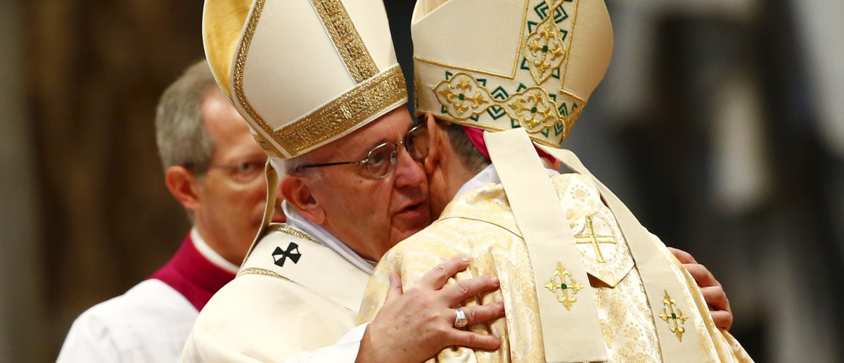 Pope Francis embraces newly ordained bishop Miguel Angel Ayuso Guixot from Spain during an ordination ceremony in Saint Peter's Basilica at the Vatican March 19, 2016. REUTERS/Tony Gentile