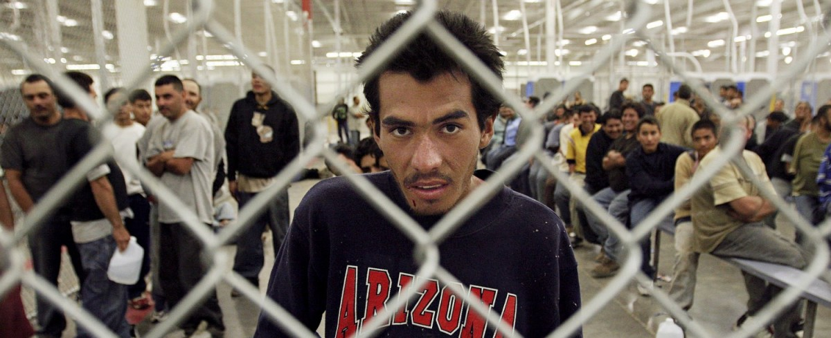 Carlos Omar, 20, of Los Moches, Sinaloa, Mexico, waits in the U.S. Border Patrol detention center in Nogales, Arizona, after being caught in the Arizona desert May 31, 2006. REUTERS/Jeff Topping