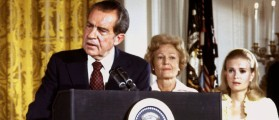 President Richard Nixon (L), listened to by First lady Pat Nixon and daughter Tricia Nixon (R), says goodbye to family and staff in the White House East Room on August 9, 1974. On Monday it will be 25 years since Nixon resigned his office, or