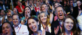 Delegates cheer as an image of Republican presidential candidate Mitt Romney is displayed during the opening session of the Republican National Convention in Tampa, Florida