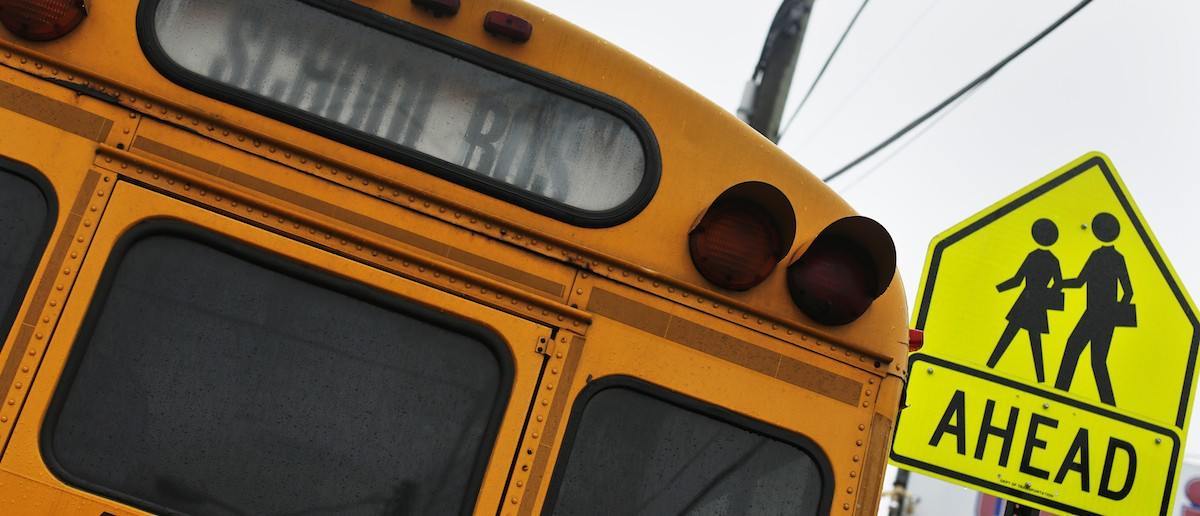 A school bus sits parked along a street in the Queens borough of New York