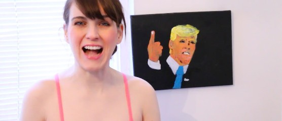 Woman paints photo of Donald Trump using her breasts