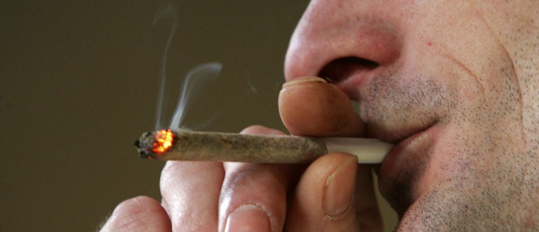 A man smokes a cigarette of marijuana in an Amsterdam cafe on 7 February 2007, Amsterdam, Netherlands. (Christopher Furlong/Getty Images)