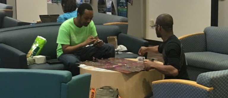 College students play a board game at George Washington University. (DCNF photo)