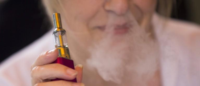 A woman smokes an electronic cigarette in London