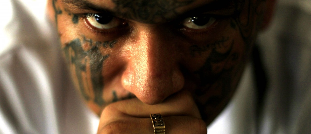 Walter Geovani Salguero, 30, an inmate and member of El Salvador's Mara Salvatrucha (MS-13) gang, participates in a pledge event during a news conference at the Sonsonate jail, outside San Salvador February 8, 2013. REUTERS/Ulises Rodriguez