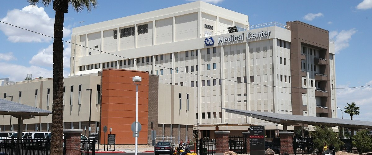 Exterior view of the Veterans Affairs Medical Center on May 8, 2014 in Phoenix, Arizona. The Department of Veteran Affairs has come under fire after reports of the deaths of 40 patients forced to wait for medical care at the Phoenix VA hospital. Christian Petersen/Getty Images.