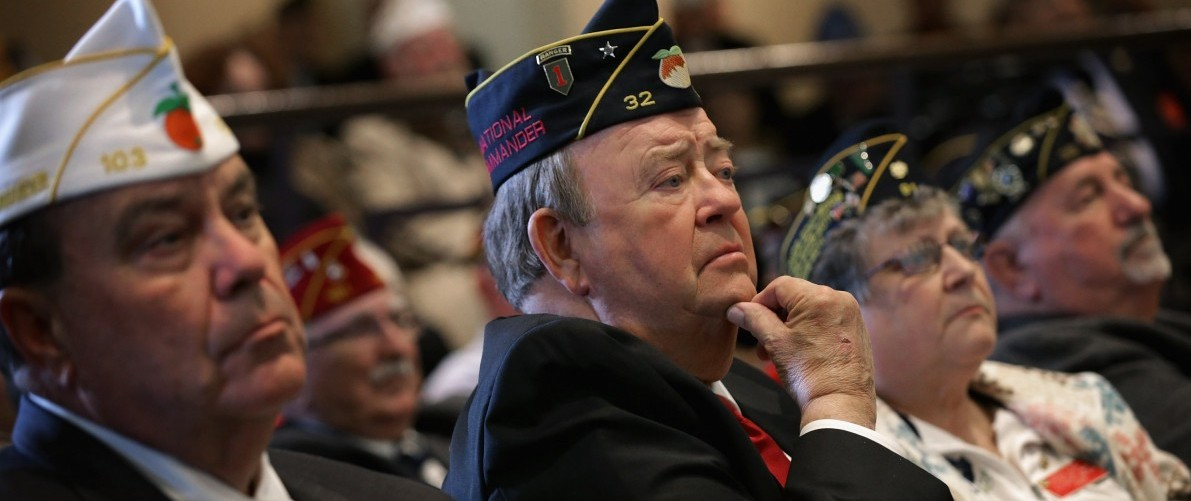 Members of the American Legion listen to U.S. Veterans Affairs Secretary Robert McDonald apologize for misrepresenting his military record during the legion's annual conference at the Washington Hilton February 24, 2015 in Washington, DC. (Chip Somodevilla/Getty Images)