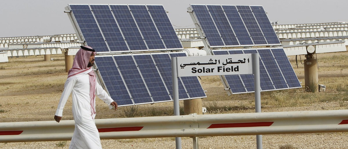A Saudi man walks on a street past a field of solar panels at the King Abdulaziz city of Sciences and Technology, Al-Oyeynah Research Station, May 21, 2012. Saudi Arabia, the world's top oil exporter, may finally be getting serious about overcoming the technical and financial hurdles for tapping its other main resource: sunshine. Saudi Arabia wants to generate much more solar power as it lacks coal or enough natural gas output to meet rapidly rising power demand. Doing so would allow it to slash the volume of oil it burns in power plants bankrolled by billions of dollars worth of saved oil earnings. Picture taken May 21, 2012. REUTERS/Fahad Shadeed