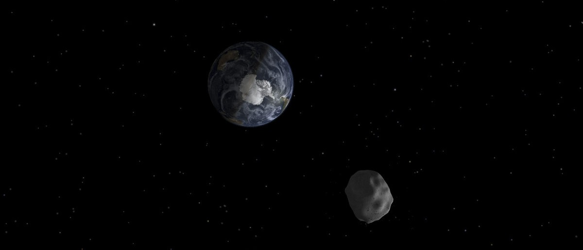 The passage of asteroid 2012 DA14 through the Earth-moon system, is depicted in this handout image from NASA. On February 15, 2013, an asteroid, 150 feet (45 meters) in diameter will pass close, but safely, by Earth. The flyby creates a unique opportunity for researchers to observe and learn more about asteroids. REUTERS/NASA/JPL-Caltech/Handout