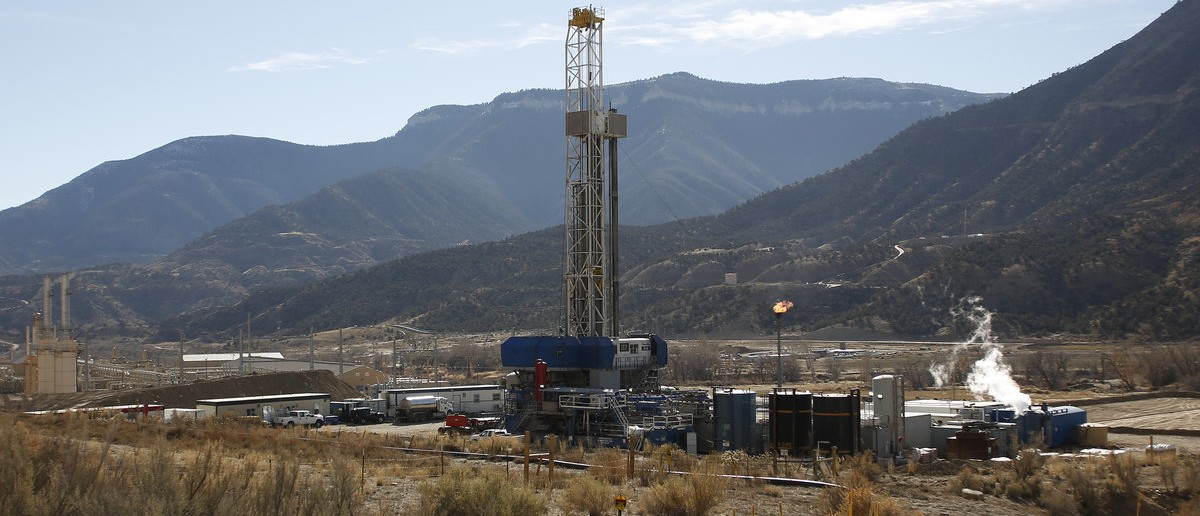 """A WPX Energy natural gas drilling rig north of Parachute, Colorado, December 9, 2014. The economy of Parachute, with a current population of approximately 1000 people, was devastated when thousands of workers lost their jobs on """"Black Sunday"""" in 1982, after Exxon terminated the Colony Shale Oil Project. The current rise of hydraulic fracking in natural gas retrieval has given a cautious hope to the town's inhabitants, who know market demand and price can effect their local economy. (Reuters/Jim Urquhart)"""