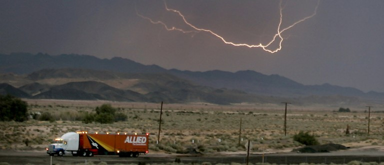 Lightning strikes across the skies of Barstow in California during a monsoon August 8, 2005. Heavy rain continue to pound on the southern Californian desert for the third week. REUTERS/Gene Blevins
