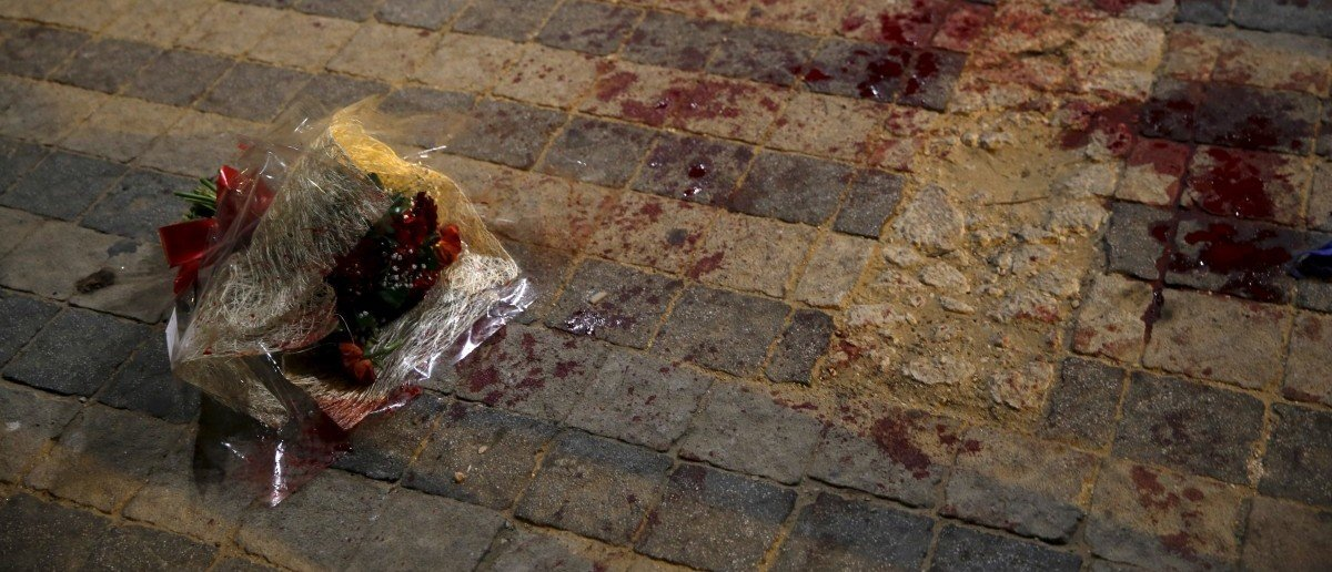 A bouquet stained with blood is seen where, according to Israeli police spokesperson, at least 10 Israelis were stabbed, in the popular Jaffa port area of Tel Aviv, Israel March 8, 2016. REUTERS/Amir Cohen