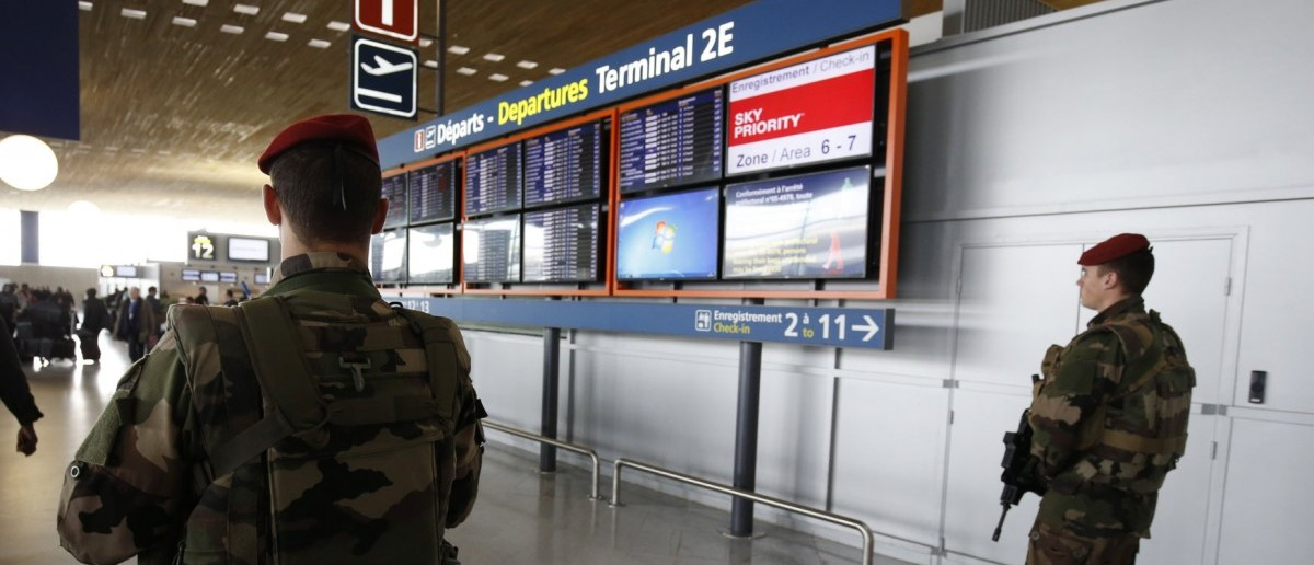 French soldiers patrol inside the Charles de Gaulle International Airport in Roissy, near Paris, France, March 23, 2016 as France has decided to deploy 1,600 additional police officers to bolster security at its borders and on public transport following the bomb attacks in Brussels. REUTERS/Philippe Wojazer