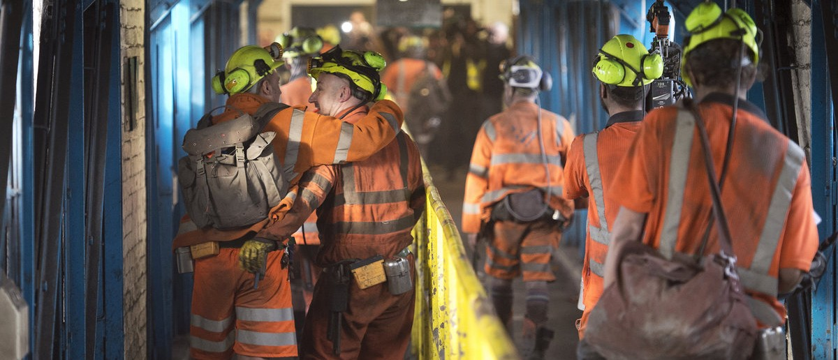 Miners leave after working the final shift at Kellingley Colliery on its last day of operation in north Yorkshire, England, December 18, 2015. Kellingley is the last deep coal mine to close in England, bringing to an end centuries of coal mining in Britain. REUTERS/Oli Scarff/Pool