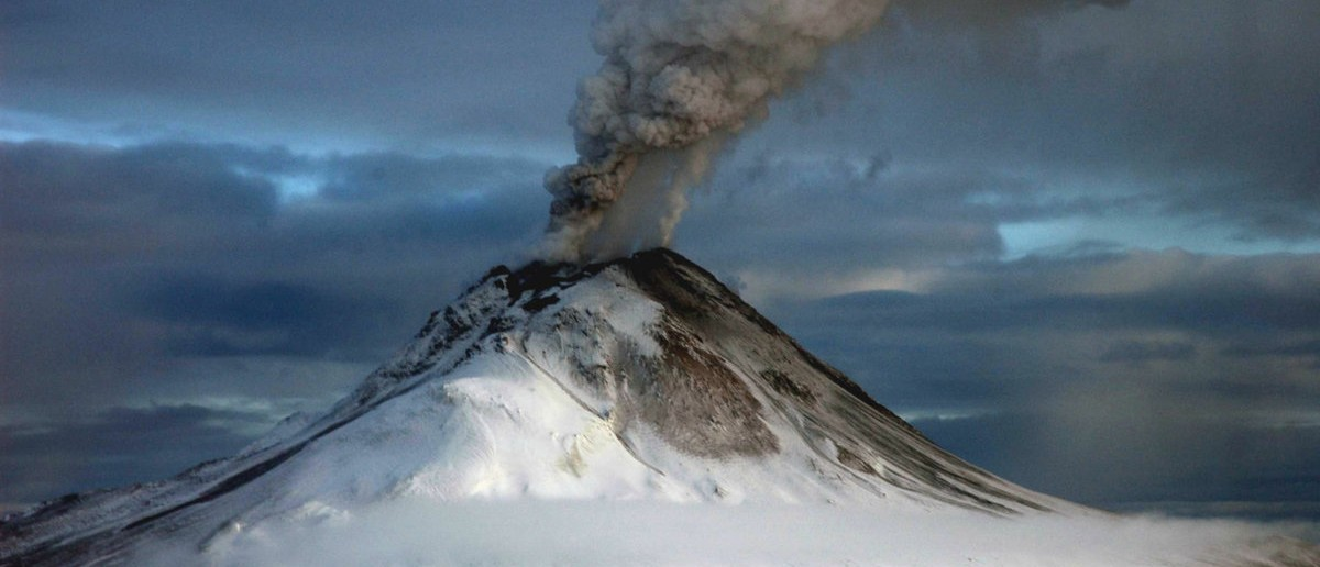 A U.S. Geological Survey handout, photographed from the west, shows Augustine volcano's summit on January 12, 2006. Augustine volcano, which erupted twice on Wednesday, erupted again on January 13, 2006 at approximately 8:47 AM AST (17:47 GMT). [Pilot reports and satellite imagery confirm an ash cloud with lightning in excess of 30,000 ft above sea level that is moving eastward. Similar short-lived explosive activity is expected to continue over the next several days or weeks, according to the volcano observatory.] Game McGimsey/Alaska Volcano Observatory/U.S. Geological Survey
