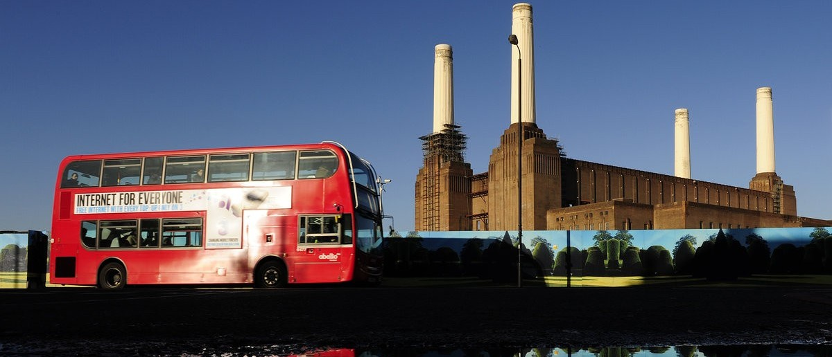 Battersea Power Station is seen reflected in water in west London December 4, 2009. REUTERS/Toby Melville