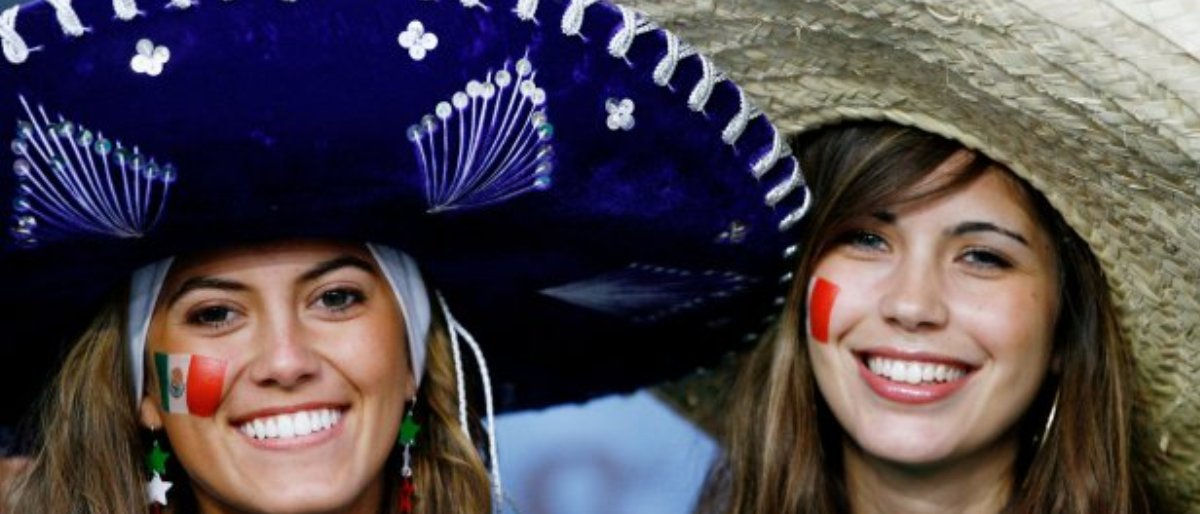 Women in large sombreros (Getty Images/Clive Mason)