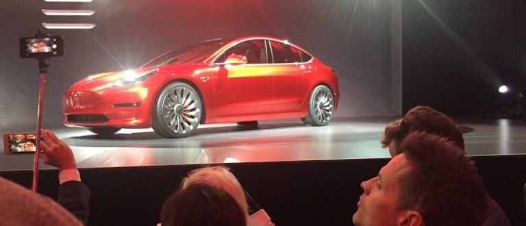 A Tesla Model 3 sedan, its first car aimed at the mass market, is displayed during its launch in Hawthorne, California, March 31, 2016. Picture taken March 31, 2016.